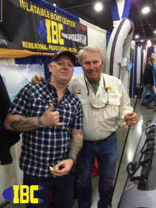 IBC Pro Mike takes a second to have a brat and tell bass fishing stories with friend Rowland Martin at the IBC Both.